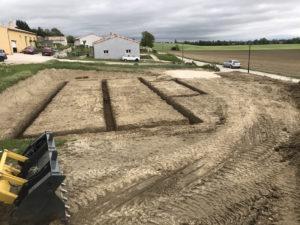 Terrassement des fondations d'une maison